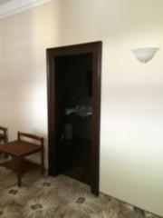 Blur interior design, hotel bedroom detail, bathroom wooden door, carpet floor