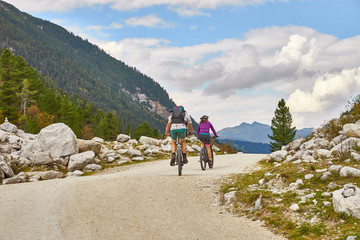Hiking and biking on a trail in Krimml valley in Austria
