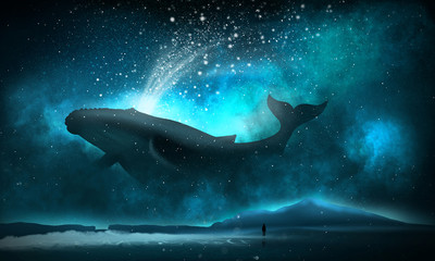 The depths of the sun through the water, the underwater world, the sea floor. Sea fantasy, big whale, sperm whale, the silhouette of a man by the sea. Night view.