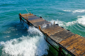wooden pier washed by sea waves