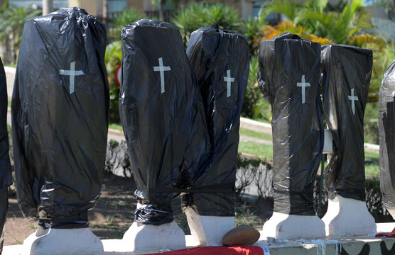 Black plastic bags with taped crosses cover stone letters of the name Brumadinho, after a dam owned by Brazilian mining company Vale SA collapsed, in Brumadinho