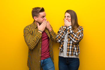 Couple in valentine day covering mouth with hands