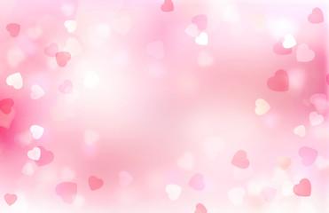 Valentine pink blurred hearts background.