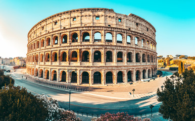 Fototapete - The ancient Colosseum in Rome at sunset