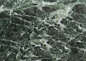 Textured grey marble stone with white streaks
