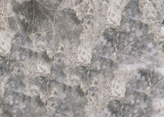 Textured smooth grey marble floor with white streaks