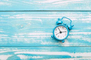 clock, alarm clock on a blue vintage background, copy space, banner
