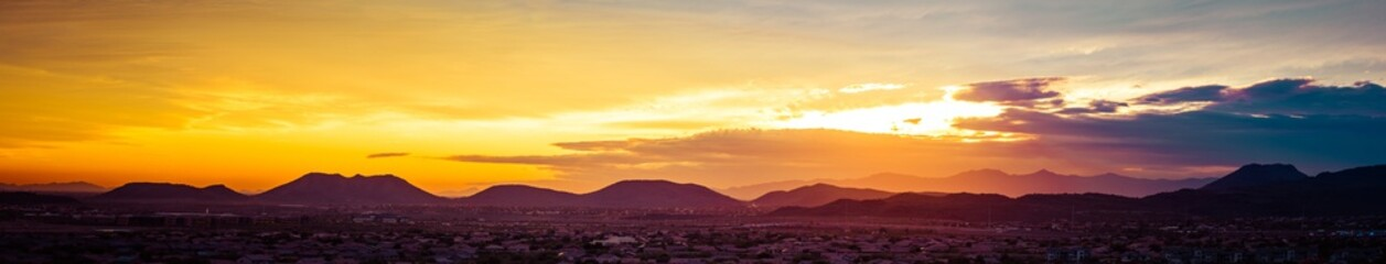 A panorama of a colorful sunset over the desert of the American Southwest in Arizona.