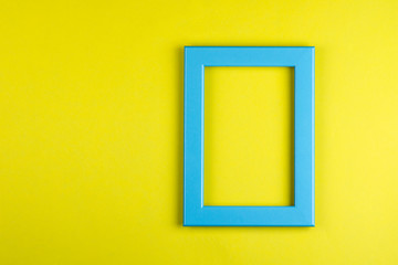 turquoise photo frame on yellow background