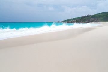 The beach with white sand and turquoise water with waves