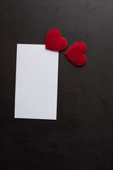 Red Heart paper and blank with note card on wall background