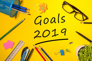 2019 goals text on office table. Top view, flat lay. Targets, goal, dreams and expectation for the next year