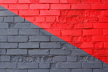 Colorful (grey and red) brick wall as background, texture