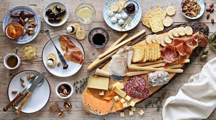 Papiers peints Entree Appetizers table with various of cheese, curred meat, sausage, olives and nuts Festive family or party snack concept. Overhead view.