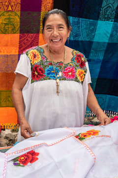 Portrait of a Mayan woman in Yucatan. Tailor specializing in embroidery clothing