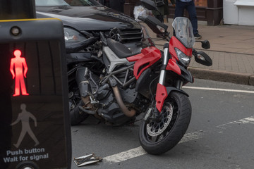 dramatic collision between motorcycle and car at zebra crossing