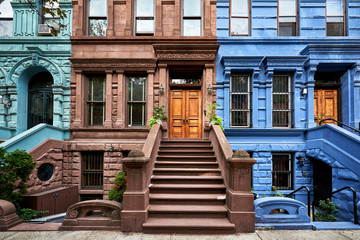 a view of a row of historic brownstones in an iconic neighborhood of Manhattan, New York City