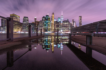 View on Financial district at night from the pier with reflection