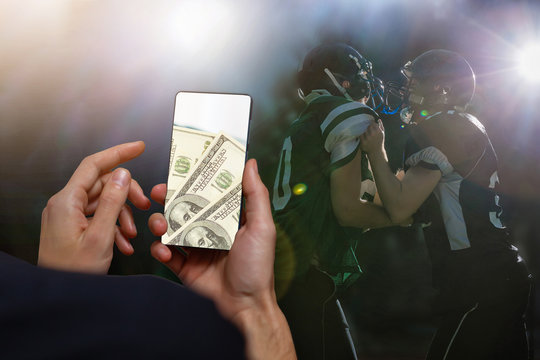 using mobile phone and betting during a football or soccer match