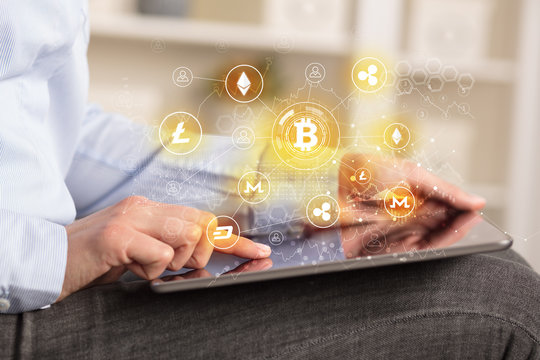 Business woman using tablet with cryptocurrency bitcoin link network concept