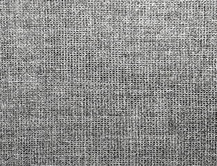 The background of textured gray natural fabric for text, banner, poster, label, sticker, layout.