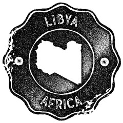 Libya map vintage stamp. Retro style handmade label, badge or element for travel souvenirs. Black rubber stamp with country map silhouette. Vector illustration.