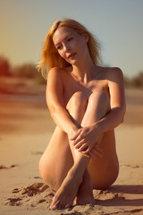 Beautiful girl model on sandy beach of the sea on tropical resort in summer