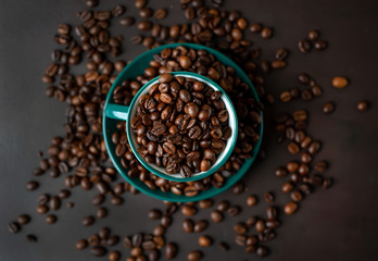 Coffee cup with coffee beans on a stone background
