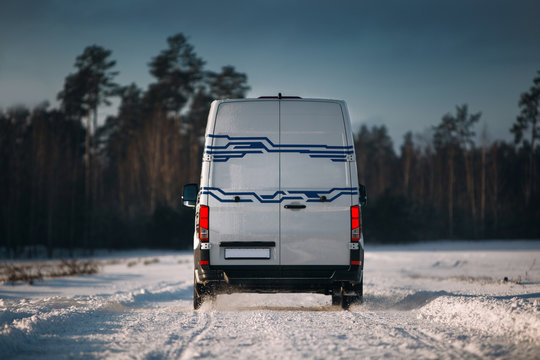 White cargo van ride very fast at winter