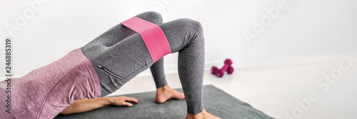Fitness resistance band glute bridge with hip abduction