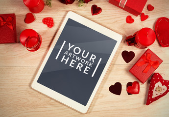 Tablet Surrounded by Valentine's Day Elements