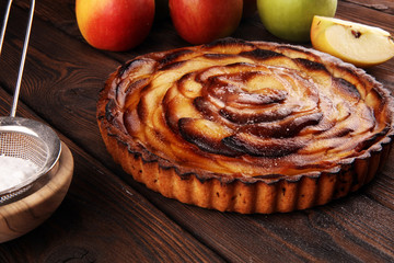 Apple tart. Gourmet traditional holiday apple pie sweet baked dessert food with cinnamon and apples on table