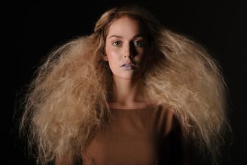 Girl in wig on dark background
