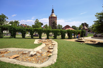 Public park and playground for children in front of the old water tower Wasserturm, built in 19th century. Vienna, Austria.