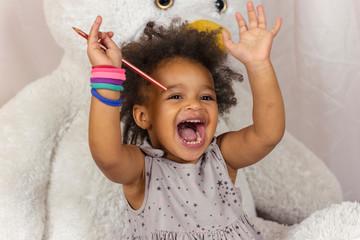 Cheerful toddler having fun
