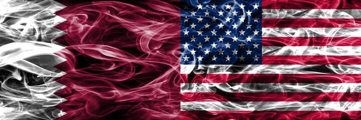 Qatar vs United States of America, American smoke flags placed side by side. United Arab Emirates. UAE.