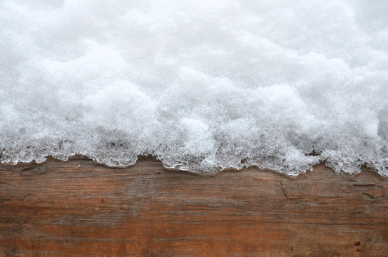 The graphic resource consists of wood and snow textures.
