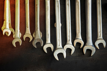 Collection of wrench hanging with Dark Textured Background,Set of wrenches,different wrenches