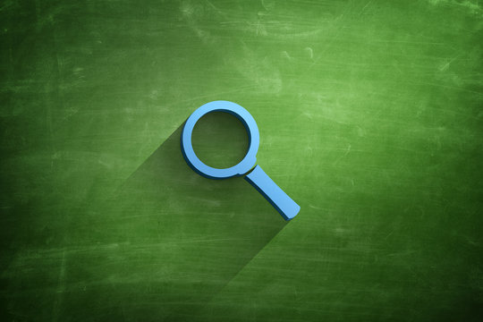 Magnifying glass icon on blackboard background