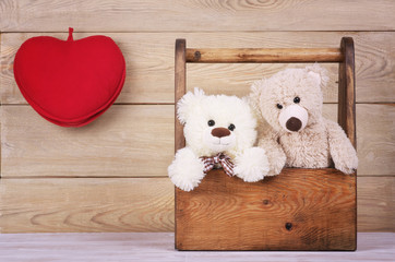 two teddy bears in the box with heart