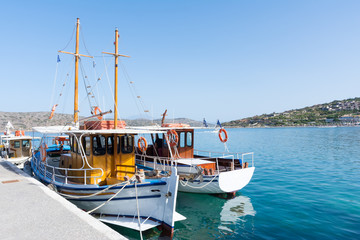 Crete. Pleasure boat near the pier to transport tourists to the island of Spinalonga