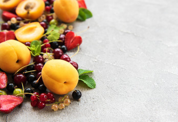 Fresh summer fruits on a concrete background