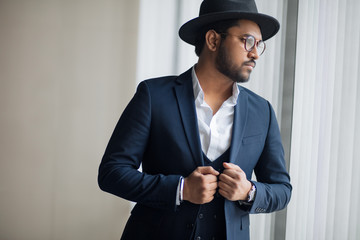 Handsome elegant man with hat looking aside. close up photo. fashion. style, lifestyle concepts