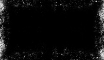 Vintage scratched grunge border overlays on isolated black background for copyspace.