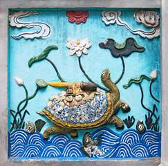 Hanoi, VIETNAM - JANUARY 12, 2015 - Ceramic decoration of entrance in Ngoc Son temple, Hanoi