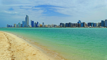 Abu Dhabi panoramic view across clear sea and Corniche Beach