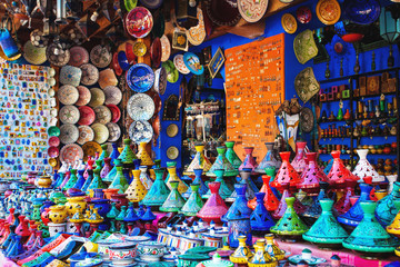 Poster Morocco Colored Tajine, plates and pots out of clay on the market in Mor