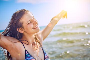 Happy Girl having fun on tropical beach