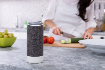 Close-up Of Voice Assistant Speaker On Kitchen Counter