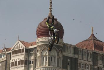 Julien Vanstippen of Belgium performs during the freestyle motocross games Red Bull FMX Jam in front of Taj Mahal hotel in Mumbai